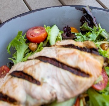 Grilled chicken breast on a salad