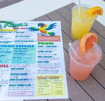 Printed drink menu with different cocktails next to it